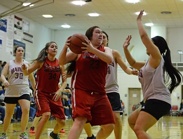 Hoonah's Mariah Martin (23) rebounds against Haines in a Women's Bracket game at the Juneau Lions Club 71st Annual Gold Medal Basketball Tournament at Juneau-Douglas High School on Tuesday. Haines won 62-55. (Photo courtesy Klas Stolpe)