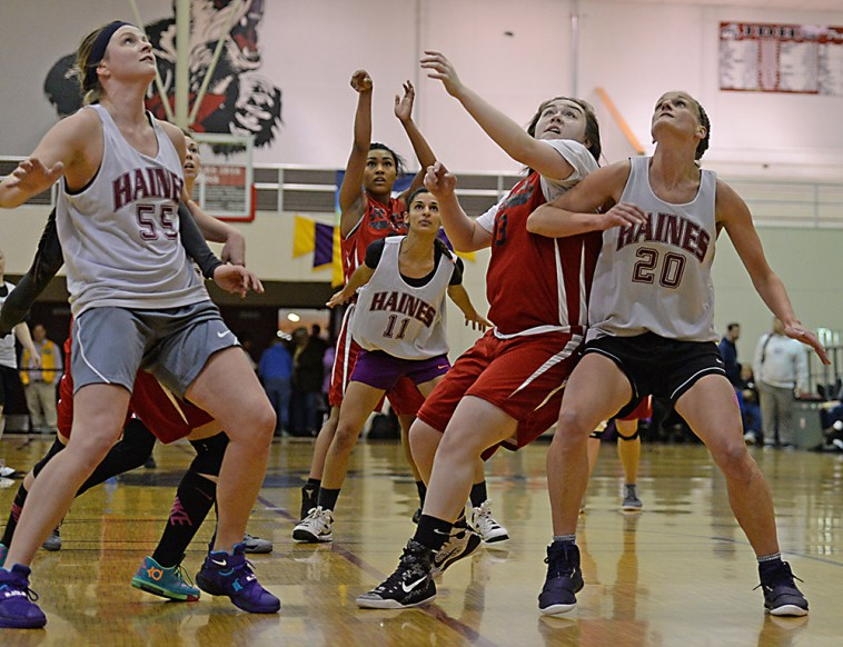 Haines and Hoonah players during the Women's Bracket championship of the Juneau Lions Club 71st Annual Gold Medal Basketball Tournament at Juneau-Douglas High School on Saturday. Haines won 52-30. (Photo courtesy Klas Stolpe)