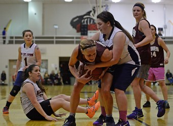 Haines and Yakutat players battle for a rebound during their Womens Bracket semifinal in the Juneau Lions Club 71st Annual Gold Medal Basketball Tournament at Juneau-Douglas High School on Thursday. Haines won 65-52. (Photo courtesy Klas Stolpe)