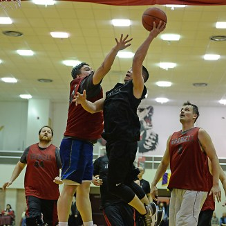 Wrangell's Eric James defends on Hydaburg's Vinny Edenshaw during a B-Bracket elimination game in the Juneau Lions Club 71st Annual Gold Medal Basketball Tournament at Juneau-Douglas High School on Wednesday. Wrangell won 87-68. (Photo courtesy Klas Stolpe)