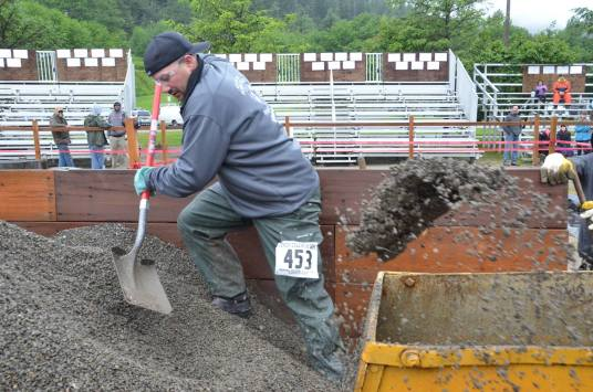 Competitor in the men's hand mucking competition.