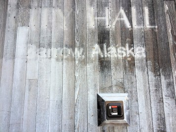 On the outside of the City Hall building, you can still see the shadow of the name 'Barrow.' June 5th, 2018. (Photo by Ravenna Koenig/ Alaska's Energy Desk).