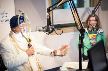 """""""The Great Orzoni,"""" a.k.a. Mark Whitman, and Libby Stringer (right). (Photo by Annie Bartholomew/KTOO)"""