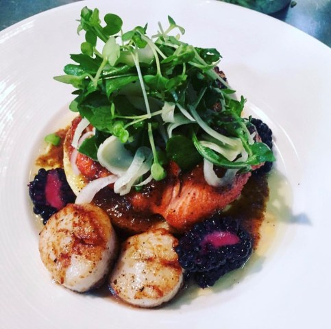 Abby LaForce's roasted Alaskan sockeye salmon, seared scallops, polenta, local micro greens, brown butter and blackberries. (Photo courtesy of Abby LaForce)