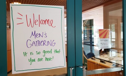 A sign in the Egan Library at the University of Alaska Southeast in Juneau welcomes participants to the Men's Gathering on June 30, 2019.