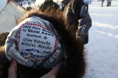 The beaver mitts made by Oline Petruska of Nikolai and presented to Richie Diehl for his first place arrival to the community on Tuesday. (Photo by Zachariah Hughes/Alaska Public Media)