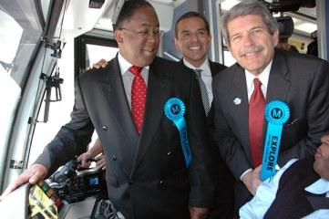 From left, Los Angeles County Supervisor Mark Ridley-Thomas, Mayor Antonio Villaraigosa and County Supervisor Zev Yaroslavsky, with inaugural train operator Carolyn Kelly. Photo: Luis Inzunza