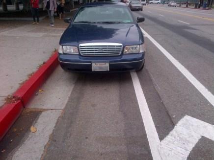 Car parked on bike lane.