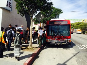 A bus shuttle picking up passengers at South Pasadena Station.