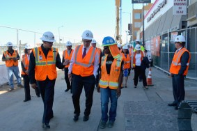WSCC James Martinez Safety Technician, Secretary Perez and LeDaya Epps walk through at the construction site at Crenshaw Blvd. and Rodeo Road. (Photo Luis Inzunza/Metro.)