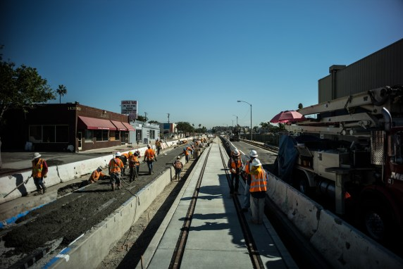Concrete being poured around the tracks on Colorado Avenue in Santa Monica.