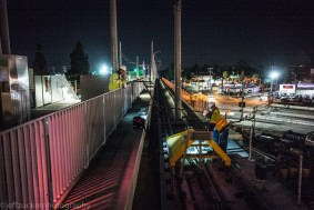 Work crews removing the train bumper from Phase One at the end of the westbound tracks at Culver City Station.
