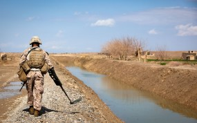 Lance Cpl. Arturo Valtierra, a mortarman with Redemption II, Weapons Company, 2nd Battalion, 1st Marine Regiment, scans for IEDs during a foot patrol to a local Afghan National Police near Patrol Base Gorgak, Garmsir District, Helmand province, Afghanistan, Feb. 13.