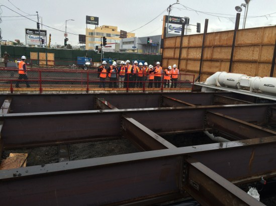 Chineses engineers looking down at the underground excavation taking place at Crenshaw/Expo and yard location. Photo Jose Ubaldo/Metro.
