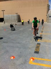 Cyclists try their hand at practicing specific maneuvering skills.