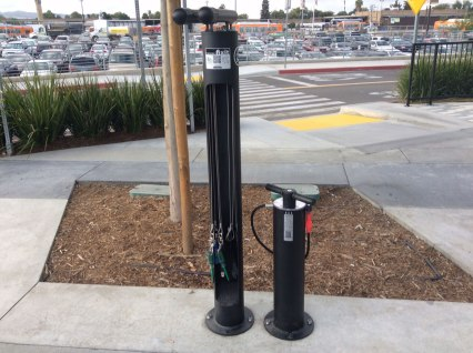 A repair stand with tools and bicycle pump are also available outside the bike hub facility.