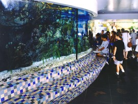 """City of Dreams, River of History by May Sun, created in collaboration with Richard Wyatt. This multimedia work includes an allegorical """"river,"""" tile benches and bronze paving inserts."""