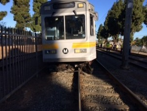 The Blue Line train derailed this morning after striking a vehicle that apparently ignored crossing gates and warning lights/bells, according to Metro. Photos by Jose Ubaldo/Metro.