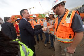 L.A. Mayor Eric Garcetti greeting workers on the project.