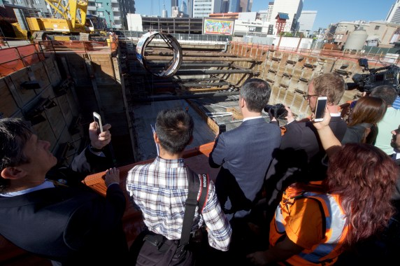 Watching the TBM piece get lowered. Photo by Gary Leonard for Metro.