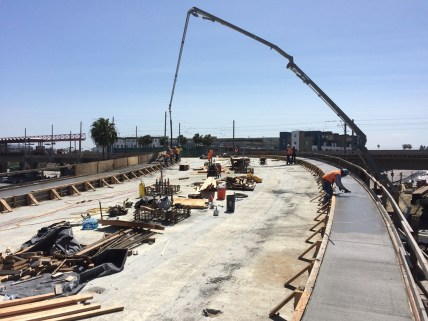Concrete placement for the multi-purpose emergency walkway on aerial structure near the junction with the Green Line.