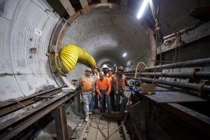 It takes about a half-dozen workers to safely build each cross passage. Photo by Gary Leonard.