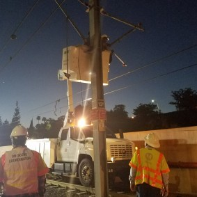 Fixing the overhead power wires. Photo: Metro