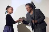 Sharon Sayles Belton being presented her award