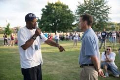 Falcon Heights Mayor Peter Lindstrom listens to activist John Thompson speak.