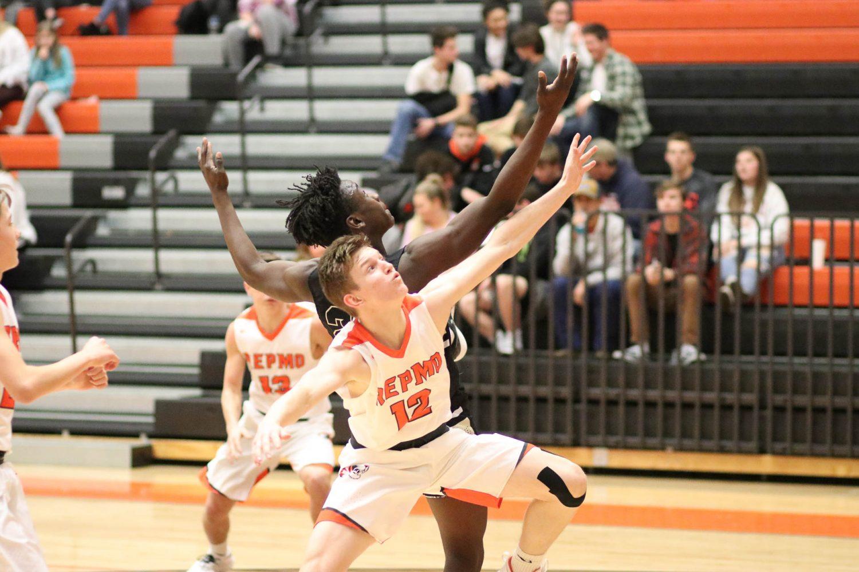 Photos:  Varsity Boys Basketball Vs Neosho