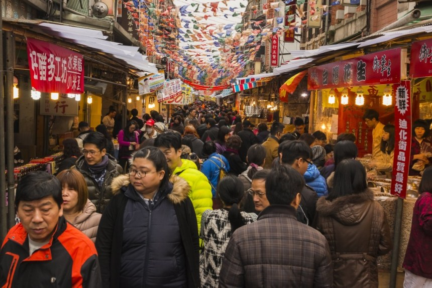 Taipei, Taiwan - January 16, 2017: Taipei residents and tourists stock up on traditional food and snacks at the Dihua St. New Year's market, the cityâs biggest New Year's market, in preparation for Lunar New Year's eve and the following New Year's holiday.