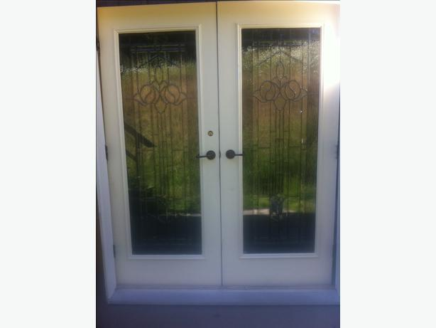 Beautiful Double Exterior French Doors With Iron Accents