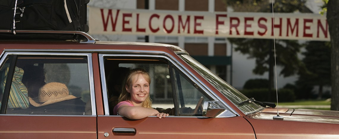 Freshman girl in car arriving to dorm