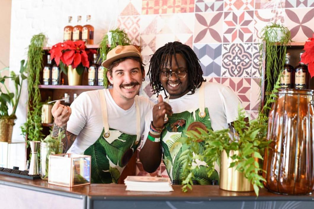 Peter Lebese and Aidan Powrie behind the bar at Old Biscuit Mill