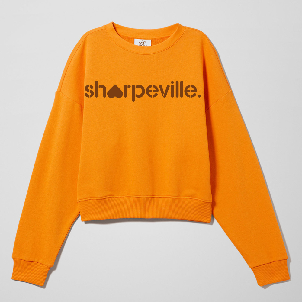 A hoodie with Sharpeville Stencil Branding