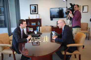 Attorney General Bob Ferguson plays a chess match with Q13 Fox News political analyst C.R. Douglas.