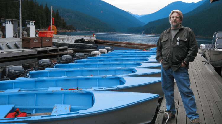 Wooden boat builder Will Shields at Ross Lake Resort. His boats are used by lodge guests.