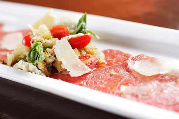A beef carpaccio with basil bread salad dish is photographed at Italia Trattoria, in Spokane, Wash., on Thursday, September 30, 2010. (Young Kwak Special to the Pacific Northwest Inlander)