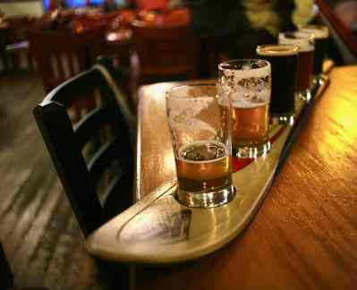 Harmon serves a flight of craft beer on a ski