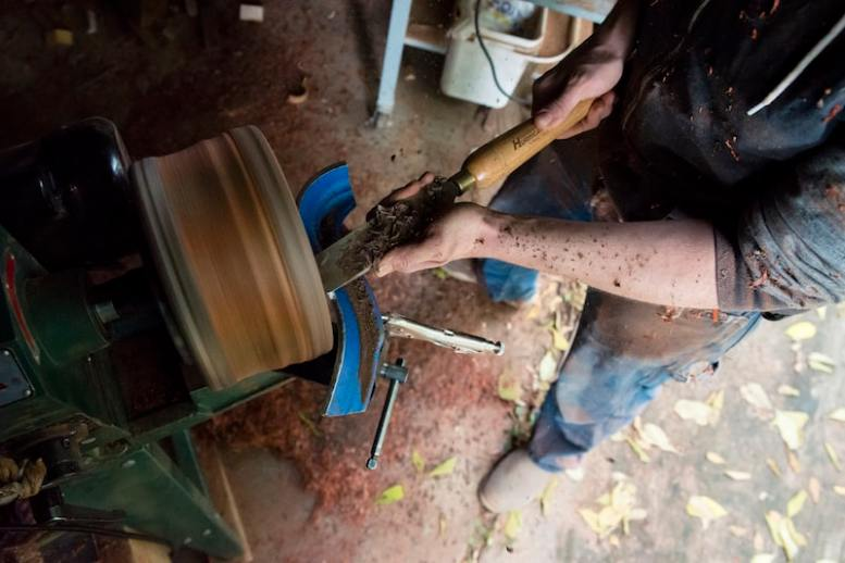 "John Furniss, The Blind Woodsman, uses his entire body to hollow out a wooden bowl with a chisel in his workdshop located in Washougal, Washington. He said about the process, ""It's almost like a dance."""