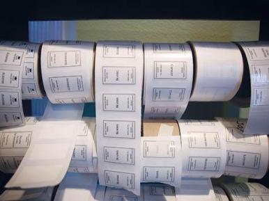 Siems keeps rolls of perfume labels readily accessible.