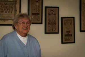 Gladys Tracey with her counter cross-stitch.