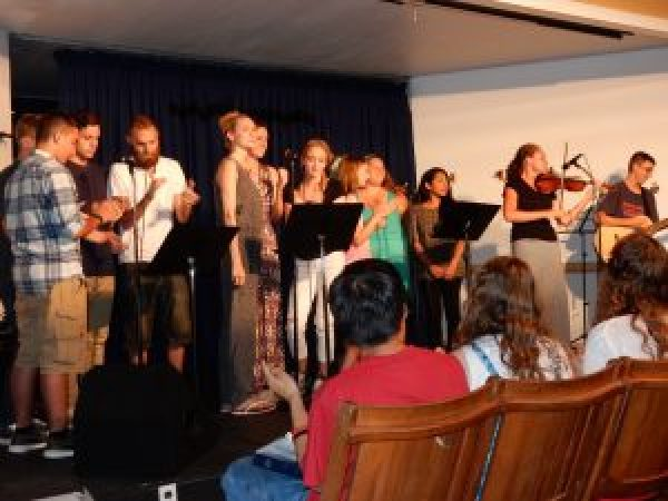 Staff and Ministry Team on stage, Boardwalk Chapel 2015, photo by Janet B.