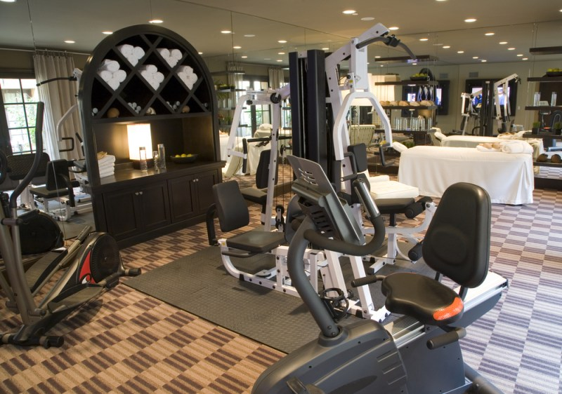 Large home gym with exercise bikes and weight lifting machines