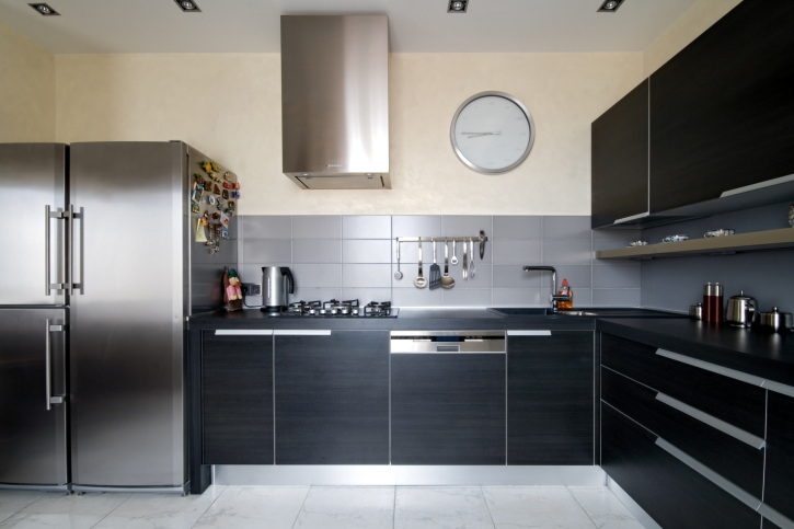 Black kitchen cabinets with white tile floor