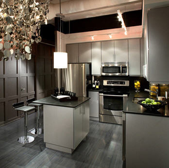 Elegant dark kitchen design with shiny dark grey flooring
