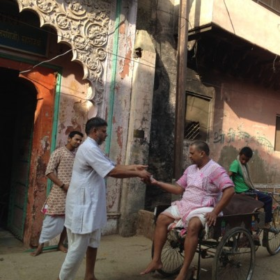 A weary pilgrim accepts prasad