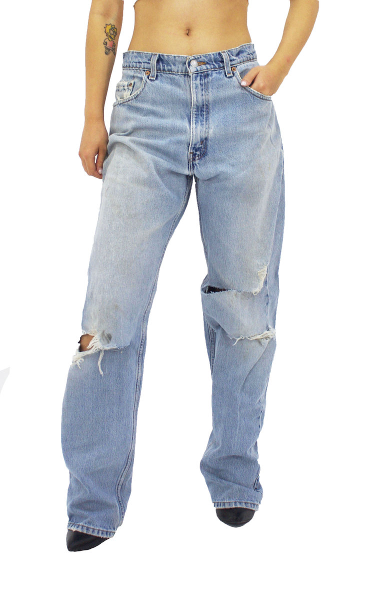 Vintage Lev'is made in America and reworked in new york city. Distressed vintage Levi's.