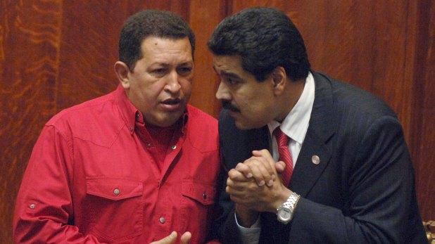 Hugo Chávez y Nicolas Maduro.