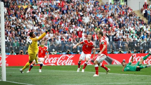 Soccer Football – World Cup – Group A – Russia vs Saudi Arabia – Luzhniki Stadium, Moscow, Russia – June 14, 2018   Russia's Yury Gazinsky scores their first goal      REUTERS/Carl Recine